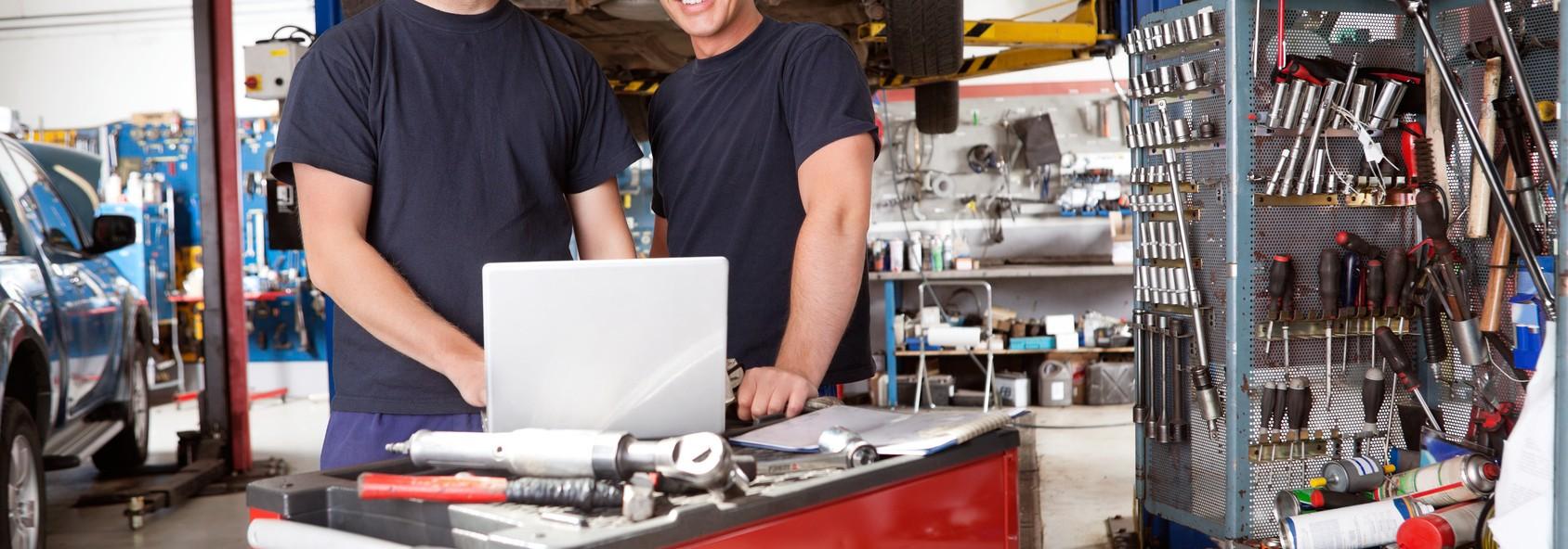 Portrait of smiling mechanics
